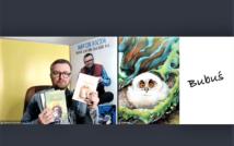 screen przedstawia mężczyznę w okularach w koszuli w kratę i kurtce dżinsowej, trzyma w rękach książki.po prawej stronie ilustracja sowy z napisem Bubuś