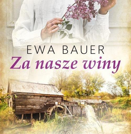 okładka książki, młoda kobieta z gałązką bzu, poniżej młyn wodny, na środku napis: EwaBrauer, Za nasze winy