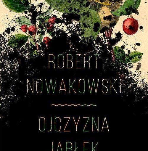 okładka książki, u góry gałązka z jabłkami, pod nią czarna ziemia a na niej napis Robert Nowakowski, Ojczyzna jabłek