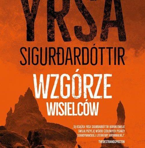okładka książki, w tle góry i napis: Yrsa Sigurðardóttir, Wzgórze wisielców