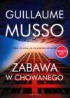 okładka książki, wieżowiec w odbiciu lustrzanym, u góry napis: Guillaume Musso, Zabawa w chowanego